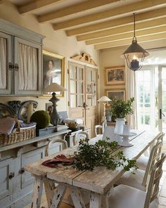 Frame a couple doors like this with mirror inserts instead of glass to reflect more light. French country kitchen