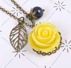 Navy Blue and Yellow Flower and Leaf Charm Necklace by cymbaline84, $14.00