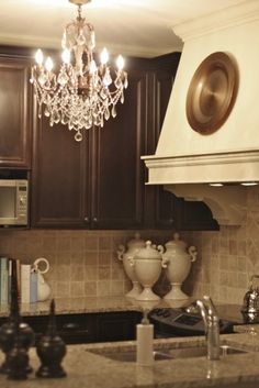 Possible combination...add color in accents for the spanish tuscan style. Yellow, red, cobalt blue. Chocolate, backsplash, countertop, with off white/antiqued white decor pieces