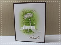 By Ariane. Stamp text. Stamp flower with Versamark and emboss in clear. Sponge with green over everything.