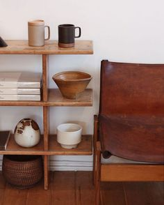 Zz Home Decor ceramics on minimalist wood shelves with vintage leather chair.Zz Home Decor ceramics on minimalist wood shelves with vintage leather chair. Interior Simple, Interior Styling, Interior Decorating, Bohemian Decorating, Bohemian Interior, Home Design, Room Inspiration, Interior Inspiration, Boutique Deco