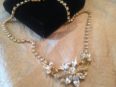 A personal favorite from my Etsy shop https://www.etsy.com/listing/510069619/crown-trifari-clear-rhinestone-and-gold