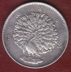 Burma silver rupee with peacock -- so pretty! Can't read the year.