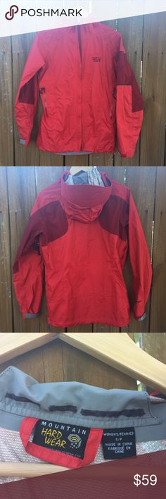 Mountain Hard Wear Womens Rain Jacket +Mountain Hard Ware Womens Rain Jacket +Originally $150 +Small +Red +Some signs of wear - one kindling hole (small burn hole), some black unknown coloration +Unzips underneath armpits +Elastic string around hood and waist +Rain visor to keep rain out of face +Name & # of previous owner is blacked out with sharpy The North Face Jackets & Coats Utility Jackets
