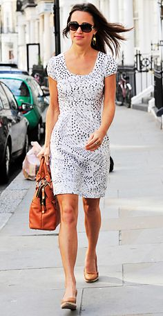 Pippa Middleton. On June 30th, Pippa Middleton showcased her summer style in a white and navy printed dress, which she paired with tan espadrille wedges.