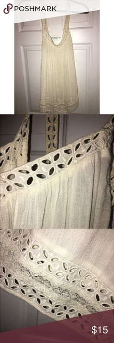 Boho Tank Top Cream colored boho peasant tank top from American Eagle. Gorgeous strap detailing! Straps cross in the back when hanging on your body. Really cute when paired underneath a cardigan or on it's own in the summer. American Eagle Outfitters Tops Tank Tops
