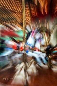 Zooming in traditional fairground carousel horse. Abstract image depicting the speed of carousel.