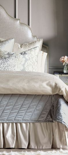 Supple fabrics, jewel beaded features, and surprising designs have added to the innate charm of satin textures gloriously showcase cosmopolitan designs such as a bold, sequin bolster and decorative shams that inspire an opulently glam nature.#bedding #luxurybedding #designerbedding #bedroomideas #decoratingideas #masterbedroom #duvetcovers #comforters #luxe #glamorous