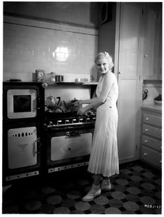Jean Harlow in her kitchen, 1930's - notice the subway tiles