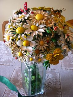 Daisy brooch bouquet with ladybugs and a grasshopper.