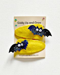 Bat Hair Clip Set  You will receive 2 Bat Clips in this set  An exclusive Giddy Up and Grow original. Hand painted and materials Include 100% wool felt and high end Glitter Fabric. Attached to 50mm snap clips.  *** PLEASE READ SHOP/SHIPPING POLICIES BEFORE PURCHASING***  *** Some pieces may contain small parts. Do not leave children unattended while wearing accessories from Giddy Up and Grow. Customer acknowledges full responsibility.***  Handmade with great care and detail since 2010…