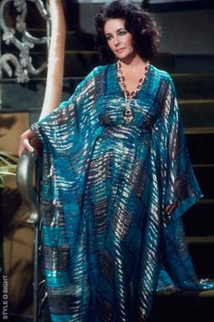 Elizabeth Taylor, 1974, in a gorgeous metallic caftan.