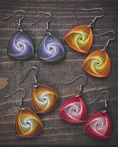 These delicately hand-crafted vortex earrings are made from 1/8 thick paper quilling strips with a stunning combination of pink and red colors! These are one of my most popular designs and they always get sold out during my art and craft shows. The earrings are attached to sterling silver hooks and can be converted to clip-on earrings as well. The earrings come in a nice gift packaging as shown in the picture (color of the box may vary). Dimensions: Hook length: 2 cm Length (without ho...