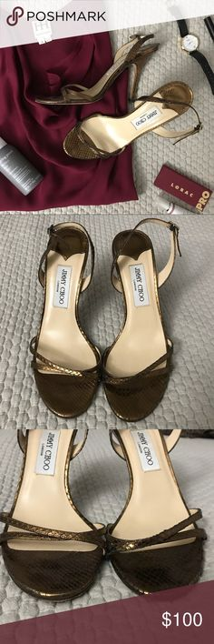 Jimmy Choo Heels Dark gold / golden brown Jimmy Choo sling back heels. These have some wear and a few knicks in the heel area, but look great on and the wear is difficult to see when wearing. Size 39.5. Jimmy Choo Shoes Heels