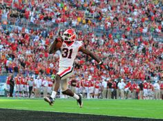 Georgia Bulldogs wide receiver Chris Conley scores the on a 87 yard Aaron Murray pass to put the Bulldogs up 45-31 in the Capital One Bowl.