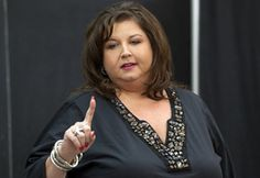 Abby Lee Miller.  The crazy dance teacher.  As a retired teacher, it saddens me that any person would speak to kids like she does. And the moms aren't much better!