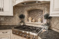 This kitchen was designed and built by the Linly Designs team, which expresses the one-of-a-kind cream finish we feature in our showroom!