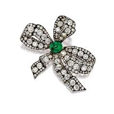 Ribbon bow diamond and emerald brooch.  Circa late 19th century.  Sotheby's