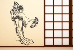 Japanese Geisha Wall Sticker. Welcome the warm Japanese culture on your home décors by pasting their typical traditional female entertainer Geisha in a thrilling dancing pose as your festive wall decal. http://walliv.com/dancing-geisha-wall-sticker-wall-art-decal