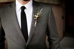 Love the dark grey suit and black tie
