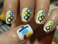 Olympics nails. I may have to try a version of this! I'll probably do gold and then just do the rings on my thumbnails, depending on how ambitious I'm feeling. (The logo on her thumb was from the Vancouver Olympics.)