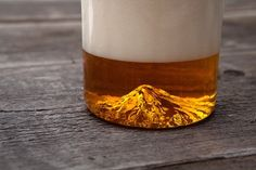 A Beer Glass with a Mountain in It