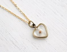 Vintage Mustard Seed Heart Pendant Necklace - 1960s Gold Tone Clear Lucite Costume Jewelry / Faith & Change by Maejean Vintage on Etsy, $24.00