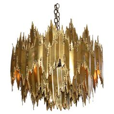 Brutalist style chandelier  Designed by Harry Weese brass chandelier 1960's. Looks very similar to a Curtis Jere piece I pinned. Wonder if the Jere was misattributed?