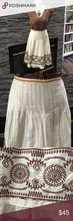 """The Limited bohemian style skirt This is an ivory skirt with zig zag detail in two colors at the top of the waist, and pleats down the waist and hips. It has a beautiful 5.5"""" band of brown circular embroidery, there are also gold sequins and small wooden beads on the band, I didn't see any missing. The skirt is lined and ivory lace peeks out from under the skirt. The waist is 15"""" across, the hips are 20"""" across, and the length including the lace is 24"""". It's a beautiful and unique piece that…"""