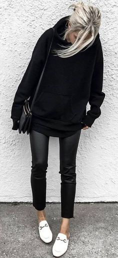 trendy black outfit: bag + sweatshirt + leather skinnies + white sneakers