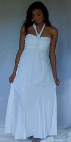 "WHITE DRESS GOWN MAXI HALTER SMOCK SEXY FITS -S M L - T562SYou'll want to reserve this glamorous dress for those most special of occasions when you want to, as they say, ""knock his socks off."" And you will....... Designed with a bandeau bodice that's ruched in the center and elastic-smocked in the back, the broad halter ties are attached at the front center and form a v-shape when you tie them at the back of the neck. The sheath-like skirt falls ..."