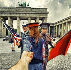 Natalia Zakharova has been leading photographer boyfriend Murad Osmann round the world for five years and the duo have recreated their pose in more spectacular images. Murad Osmann, Travel Around The World, Around The Worlds, Disneyland, Brandenburg Gate, Photographer Pictures, Photo Series, Photo Projects, Creative Photos