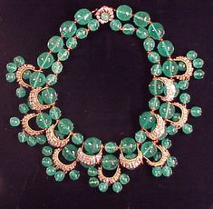 Miriam Haskell Green Bead Necklace Two strands, with rhinestone half loops hung with bead pendants, marked.  Sold for $1,600