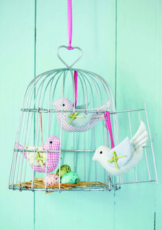 wire bird cage and fabric birds