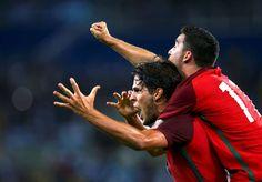 Portu-goal!:    Paciencia of Portugal, left, celebrates scoring a goal in their match against Argentina at Olympic Stadium, Rio de Janeiro, on Aug. 4, 2016.
