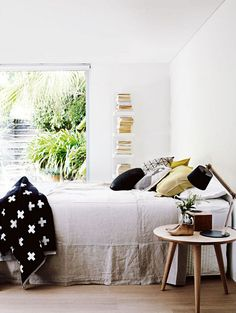 Simple Bedroom, love the bed linen and light