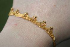 18 K Gold Solid bracelet  Part of set Stunning  so unique