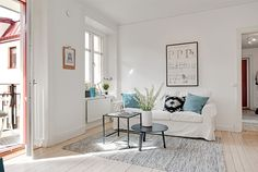 my scandinavian home: White, cognac and blue in a Swedish apartment