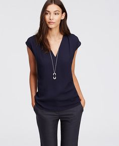 Love the look of the whole outfit.  v-neck, drapey, navy, fits at just the right spot on hip. Long necklace and perfectly fitted trouser style pants.  A+++