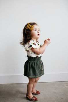 Mustard bow, boho printer top, linen buttoned skirt and a cute sandal for a super chic little girl.