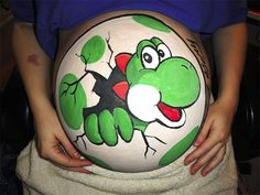 Baby Yoshi painted on a pregnant belly Yoshi, Design Blog, Pregnancy Tattoo, Pregnancy Belly, Third Pregnancy, Bump Painting, Painting Art, Pregnant Belly Painting, Pregnant Painted Belly