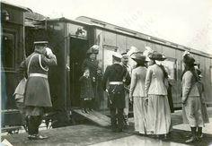 Alexandra & Alexei exit the Imperial train, joining Nicholas, Ernie, & OTMA