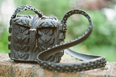 Handbag hand made from recycled bicycle tyres.