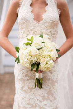 Brides.com: All-White Wedding Bouquets A sweet and simple bouquet made of white roses and hydrangeas. Photo: Robyn Van Dyke Photography