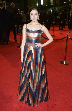 To the BAFTAs, Rising Star Award Nominee Bel Powely wore a custom Gucci multicolor lurex plisse gown with embroidered jeweled bees designed by Alessandro Michele.