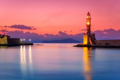 Sunset at the Venetian Lighthouse at Chania, Crete, Greece by Joe Daniel Price Beautiful Islands, Beautiful Places, Costa, Lighthouse Lighting, Places In Greece, Crete Island, Sea To Shining Sea, Amazing Sunsets, Beautiful Sunrise