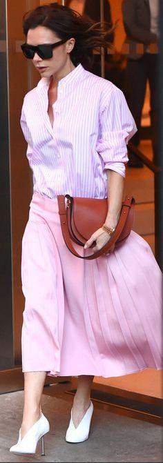 Who made  Victoria Beckham's brown handbag, pink stripe shirt, black sunglasses, and pleated skirt?