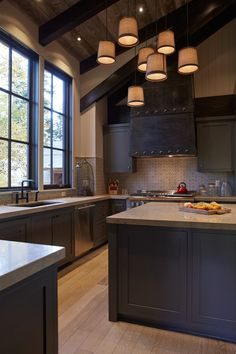 ✔ Love the pendant lighting, vaulted ceiling, neutral modern color scheme, and the unique black metal range hood.