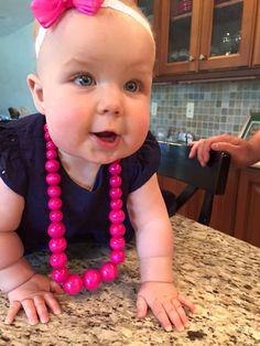 This cutie is rockin' her Fizzy Pops beads.