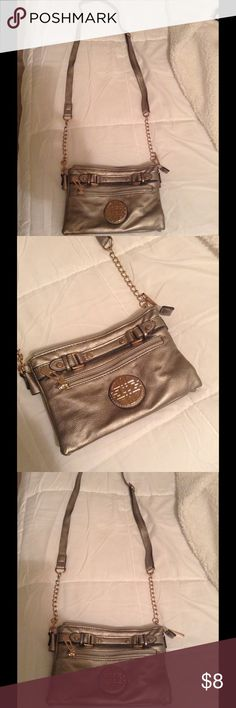 Silver and gold crossbody Silver with gold. quality made purse. new condition. Long Adjustable  strap. Bundle today and save lots Bags